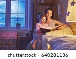 family reading bedtime. pretty... | Shutterstock . vector #640281136