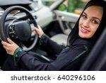 happy muslim woman driving car | Shutterstock . vector #640296106