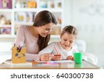 mother and daughter drawing  | Shutterstock . vector #640300738