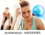 tired and sweaty but satisfied... | Shutterstock . vector #640354585