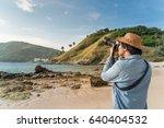 young asian man photographer... | Shutterstock . vector #640404532