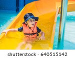 a boy in a life jacket slides... | Shutterstock . vector #640515142