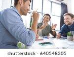 smiling young businessmen... | Shutterstock . vector #640548205