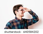 the stench. closes the man's... | Shutterstock . vector #640584202
