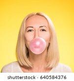 girl inflates a balloon of... | Shutterstock . vector #640584376