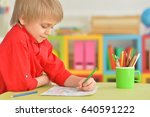 cute boy drawing with pencils | Shutterstock . vector #640591222