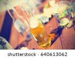 opened beer bottle standing on... | Shutterstock . vector #640613062