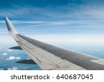 the wing of the plane on blue... | Shutterstock . vector #640687045