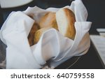 loaf of bread on black table... | Shutterstock . vector #640759558