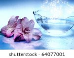 a bowl with water with mystic stars with pink lily flowers, concept for mystical holy water element - stock photo