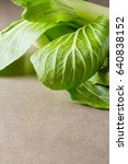 Small photo of Overhead shot of Chinese cabbage, Bok Choy, on rustic background.
