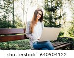 young woman with a laptop on a... | Shutterstock . vector #640904122