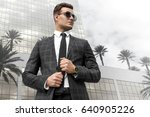 fashionable man in a suit and... | Shutterstock . vector #640905226