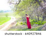 a young woman in a red dress is ... | Shutterstock . vector #640927846