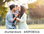 happy mother and father kissing ... | Shutterstock . vector #640938316