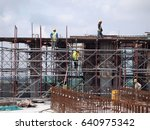 Small photo of PUTRAJAYA, MALAYSIA -JANUARY 15, 2017: Construction workers wearing safety harness and adequate safety gear while working at high level at the construction site in Seremban, Malaysia.