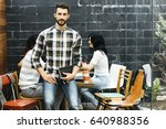worker looking at camera while...   Shutterstock . vector #640988356