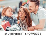 happy young family in city... | Shutterstock . vector #640990336