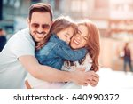 happy young family in city... | Shutterstock . vector #640990372