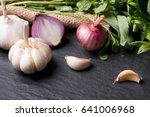 garlic and onion on the black... | Shutterstock . vector #641006968