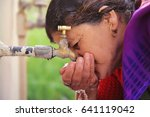 indian women drinking water... | Shutterstock . vector #641119042