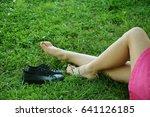 girls legs lying in grass... | Shutterstock . vector #641126185