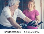 personal trainer exercise helps ... | Shutterstock . vector #641129542