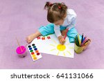 the small beautiful girl paints ... | Shutterstock . vector #641131066