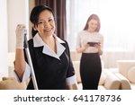 joyful positive hotel maid... | Shutterstock . vector #641178736