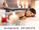 masseur makes massage to young... | Shutterstock . vector #641181376