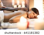 masseur makes massage to young... | Shutterstock . vector #641181382
