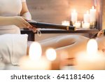 masseur makes massage to young... | Shutterstock . vector #641181406