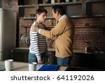 father and son having friendly... | Shutterstock . vector #641192026