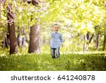 happy kid has fun outdoor in... | Shutterstock . vector #641240878