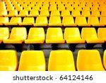 plenty of yellow plastic seats... | Shutterstock . vector #64124146
