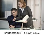 caucasian co workers looking at ... | Shutterstock . vector #641243212