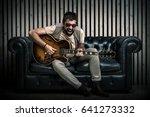 Adult Caucasian Guitarist...