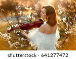 beautiful romantic girl with... | Shutterstock . vector #641277472