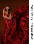 beautiful girl in a flowing... | Shutterstock . vector #641284552
