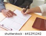 person's hand hold ballpoint... | Shutterstock . vector #641291242