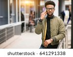 african american man ysing phone | Shutterstock . vector #641291338