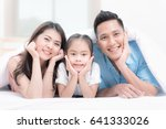 happy family on white bed in... | Shutterstock . vector #641333026
