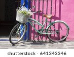 vintage bike in old color town | Shutterstock . vector #641343346