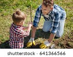 father and son planting tree in ... | Shutterstock . vector #641366566