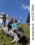 happy smiling hikers resting...   Shutterstock . vector #641372866