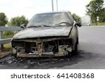 burned car on the road | Shutterstock . vector #641408368