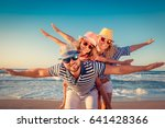 happy family on the beach.... | Shutterstock . vector #641428366