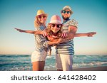 happy family on the beach.... | Shutterstock . vector #641428402