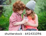 photo of two cute hipsters... | Shutterstock . vector #641431096