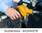 woman fills petrol into her car ... | Shutterstock . vector #641444578